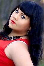 Ukrainian girl Yuliya,25 years old with green eyes and black hair.