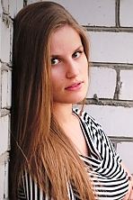 Ukrainian girl Alexandra,23 years old with green eyes and black hair.