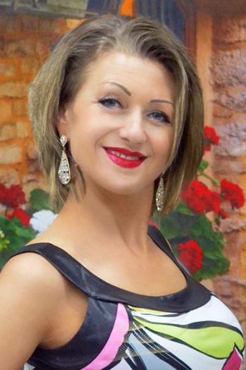 Ukrainian girl Svetlana,44 years old with blue eyes and blonde hair.