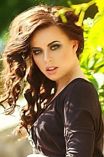 Ukrainian girl Tatiana,25 years old with blue eyes and dark brown hair.