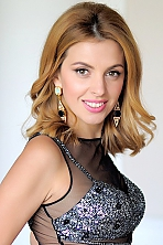 Ukrainian girl Svetlana,35 years old with green eyes and light brown hair.