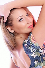 Ukrainian girl Julia,29 years old with grey eyes and light brown hair.