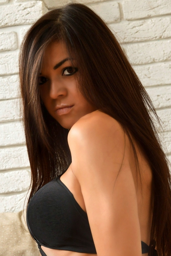 Ukrainian girl Larisa,33 years old with brown eyes and dark brown hair.