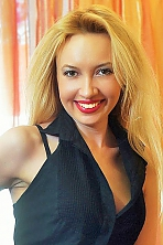 Ukrainian girl Juliya,38 years old with green eyes and blonde hair.