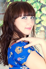 Ukrainian girl Oksana,20 years old with green eyes and light brown hair.