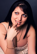 Ukrainian girl Anna,33 years old with blue eyes and dark brown hair.