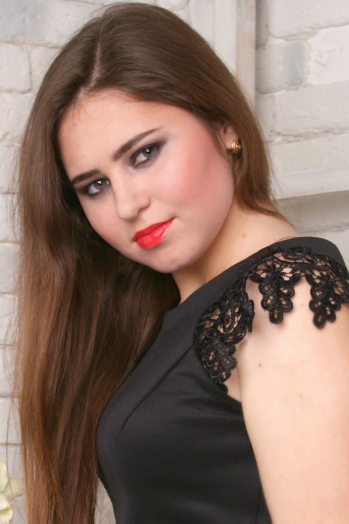 Ukrainian girl Alina,19 years old with green eyes and dark brown hair.