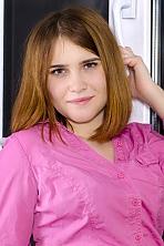 Ukrainian girl Alexandra,20 years old with blue eyes and dark brown hair.