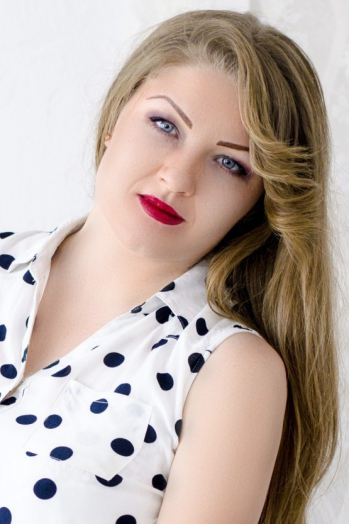 Ukrainian girl Veronica,27 years old with grey eyes and light brown hair.