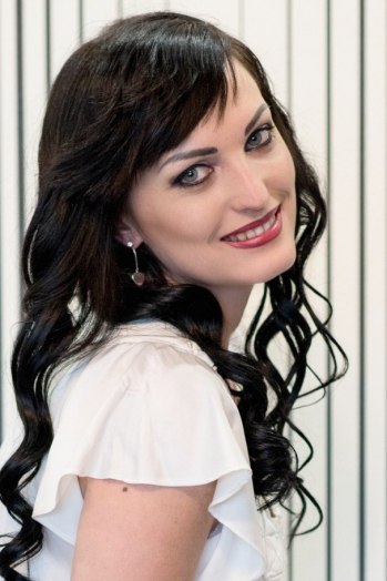 Ukrainian girl Elena,28 years old with blue eyes and black hair.