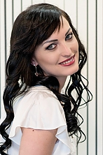 Ukrainian girl Elena,29 years old with blue eyes and black hair.