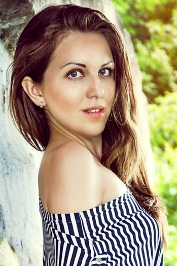 Ukrainian girl Kristina,24 years old with blue eyes and light brown hair.
