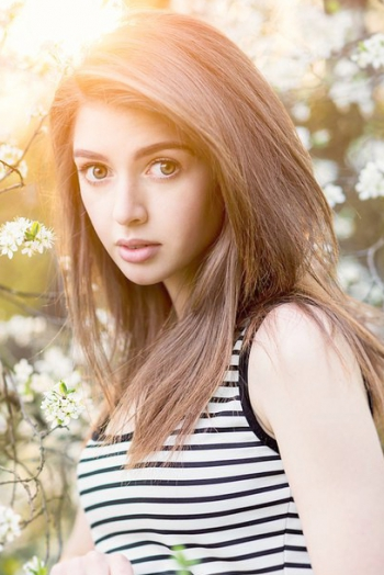 Ukrainian girl Anna,22 years old with green eyes and light brown hair.
