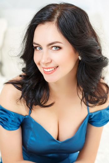 Ukrainian girl Oksana,43 years old with blue eyes and dark brown hair.