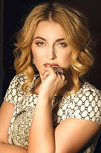 Ukrainian girl Ludmila,40 years old with green eyes and light brown hair.