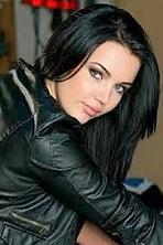 Ukrainian girl Marina,28 years old with green eyes and black hair.
