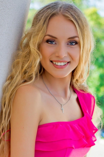 Ukrainian girl Olga,20 years old with blue eyes and blonde hair.