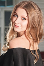 Ukrainian girl Marina,25 years old with grey eyes and light brown hair.