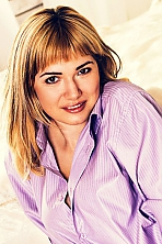 Ukrainian girl Anastasia,25 years old with grey eyes and blonde hair.