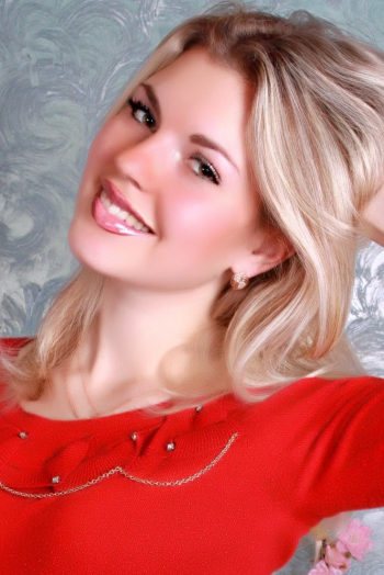 Ukrainian girl Yana,24 years old with green eyes and blonde hair.