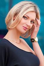 Ukrainian girl Kseniya,34 years old with green eyes and blonde hair.