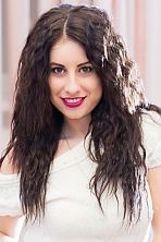 Ukrainian girl Lyudmila,27 years old with hazel eyes and dark brown hair.