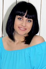 Ukrainian girl Elina,28 years old with blue eyes and black hair.