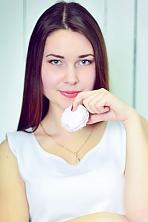Ukrainian girl Nadejda,19 years old with blue eyes and dark brown hair.