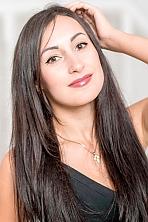 Ukrainian girl Antonina,27 years old with hazel eyes and black hair.
