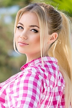 Ukrainian girl Kristina,26 years old with grey eyes and blonde hair.
