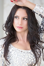 Ukrainian girl Olga,45 years old with brown eyes and dark brown hair.
