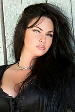 Ukrainian girl Maria,40 years old with green eyes and black hair.