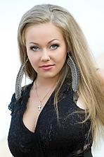 Ukrainian girl Anastasiya,26 years old with green eyes and blonde hair.