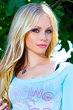 Ukrainian girl Maria,26 years old with green eyes and blonde hair.