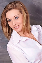 Ukrainian girl Viktoria,42 years old with blue eyes and light brown hair.