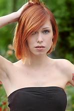 Ukrainian girl Maria,24 years old with green eyes and red hair.