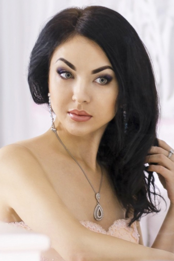 Ukrainian girl Angelina,28 years old with green eyes and dark brown hair.