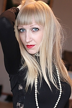 Ukrainian girl Anna,29 years old with grey eyes and blonde hair.