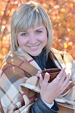 Ukrainian girl Marianna,32 years old with brown eyes and blonde hair.