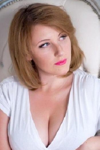 Ukrainian girl Alina,24 years old with blue eyes and dark brown hair.