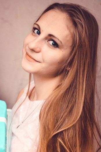 Ukrainian girl Katerina,18 years old with blue eyes and blonde hair.