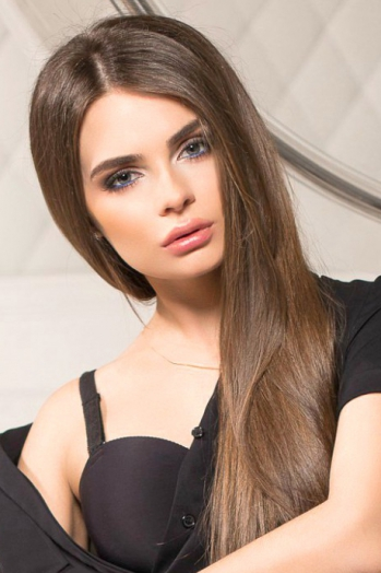 Ukrainian girl Alyona,23 years old with grey eyes and light brown hair.