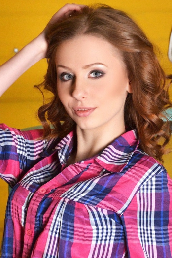 Ukrainian girl Anastasia,19 years old with blue eyes and red hair.