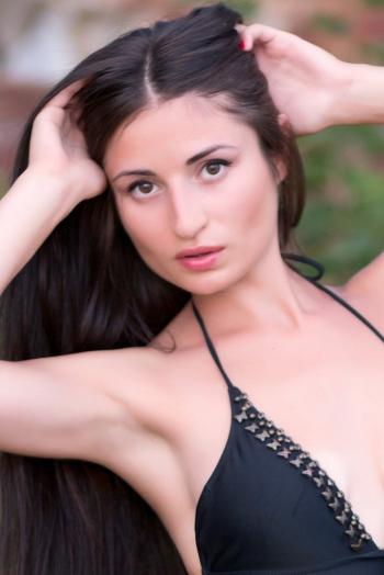 Ukrainian girl Nina,29 years old with brown eyes and black hair.