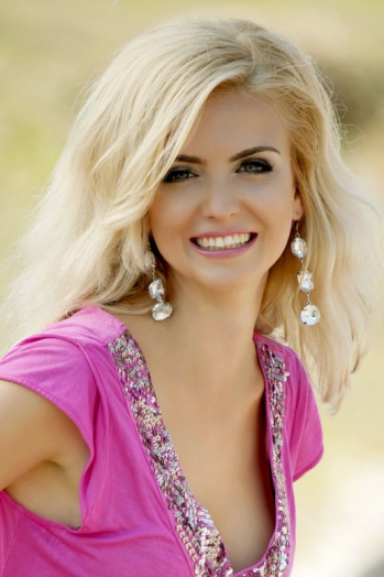 Ukrainian girl Bohdana,32 years old with blue eyes and blonde hair.