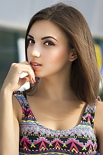 Ukrainian girl Sofia,21 years old with brown eyes and light brown hair.