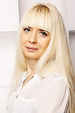Ukrainian girl Yanina,47 years old with grey eyes and blonde hair.