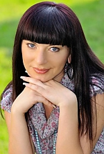 Ukrainian girl Nataliya,32 years old with blue eyes and dark brown hair.