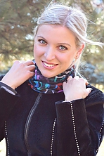 Ukrainian girl Alina,24 years old with grey eyes and blonde hair.