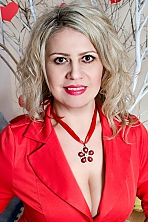 Ukrainian girl Tatyana,43 years old with brown eyes and blonde hair.